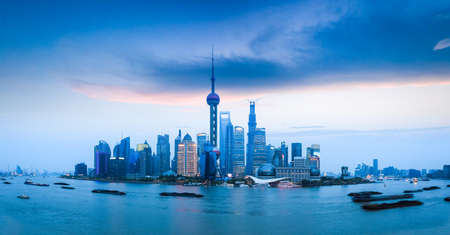 panoramic view of shanghai skyline and busy huangpu river at dusk  photo