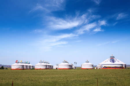 mongolian yurts on the prairie against a blue sky  photo