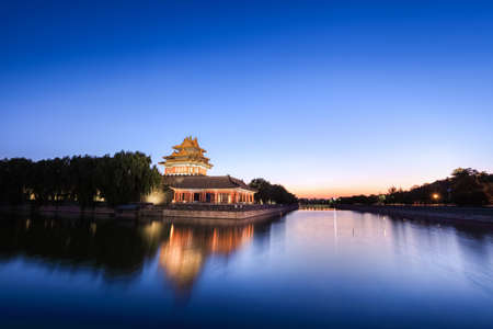 the turret and moat of beijing forbidden city at dusk ,China