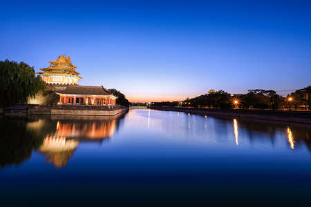 beijing moat with turret of the forbidden city in nightfall   Stock Photo
