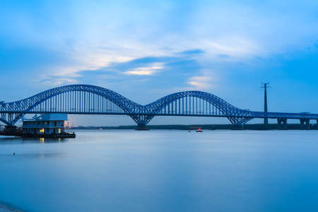 nanjing dashengguan yangtze river bridge at dusk, is the world's largest design load high speed railway bridge,China.  photo