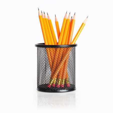 lead pencils in metal pot on a white background  photo