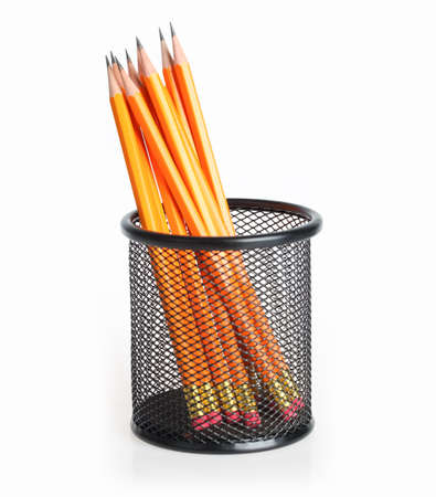 lead pencils in metal mesh cup on a white background  photo