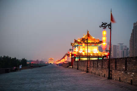chinese wall: xian ancient city wall at night, beautiful gate tower ablaze with lights