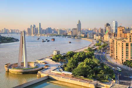 shanghai bund in sunrise with morning sun shining photo