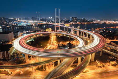 beautiful approach bridge of shanghai nanpu at night ,spiral in a complex curve  photo