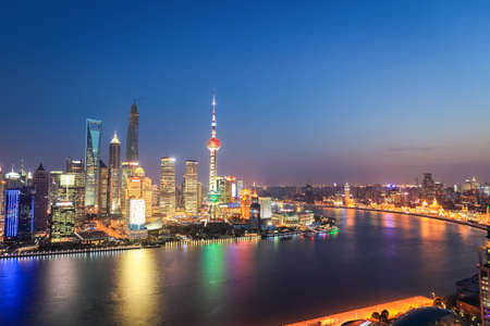 huangpu: shanghai skyline in nightfall ,when the evening lights are lit on the huangpu river    Editorial