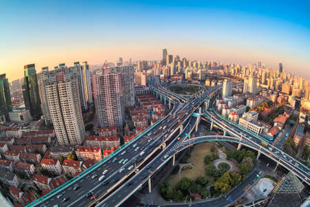 infrastructure buildings: modern city viaduct junction by fisheye view at dusk in shanghai