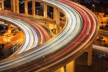 interchange: closeup of the light trails on nanpu bridge approach in shanghai at night