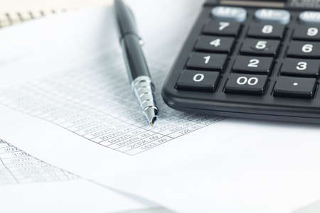 calculator and pen on the financial documents, abstract accounting business concept Imagens