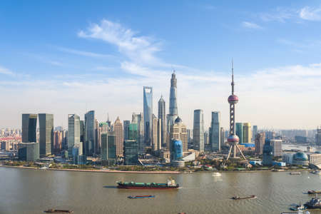 financial world: shanghai pudong skyline ,modern building with sunny sky ,China  Stock Photo