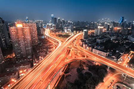 motorway: interchange overpass at night ,light trails on the city highway junction in shanghai  Editorial