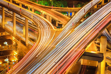 flyovers: busy traffic light trails on the multiple flyovers