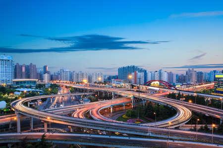 modern city interchange overpass in nightfall at shanghai