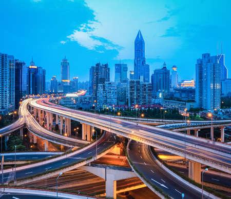 city interchange overpass at dusk in modern shanghai