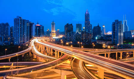 busy street: beautiful city interchange overpass at night in shanghai ,China