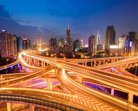 complicated city interchange overpass at night in modern shanghai   photo