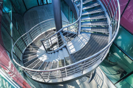 metal spiral staircase in  modern building ,upside view  photo