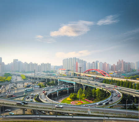 interchange: city interchange in rush hour with the early morning sky ,shanghai ,China  Stock Photo
