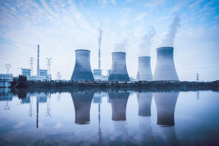 emission: thermal power plant ,cooling towers and reflection in the river  Stock Photo