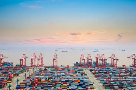 container wharf at dusk in shanghai  , the east china sea with sunset clouds