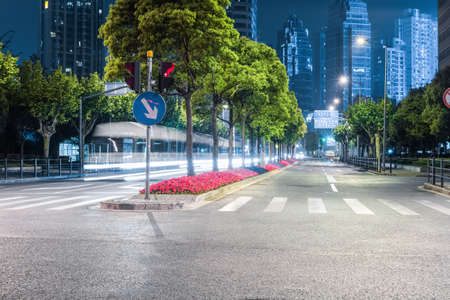 city streets at night and modern building background in shanghai photo