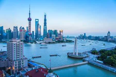 shanghai at dusk, pudong skyline and beautiful huangpu river