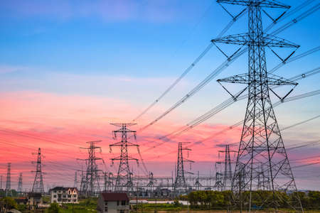electricity substation: power transmission tower silhouetted against the sunset glow  Stock Photo