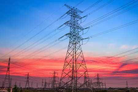 electricity pylons in transformer substation with a beautiful sunset sky