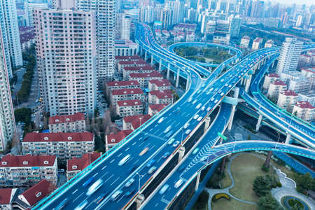 density: modern city overpass close-up, blue elevated road junction  Stock Photo