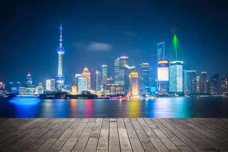 shanghai: shanghai skyline at night , light show with wooden floor prospect