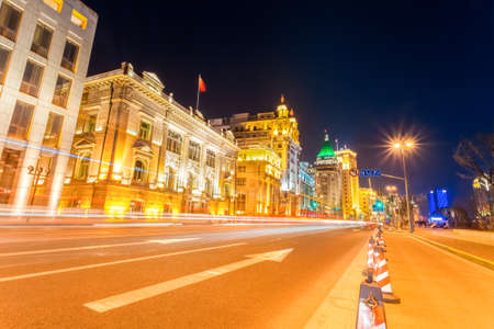 light trails on the street in shanghai the bund at night  with  outstanding historical buildings background  photo