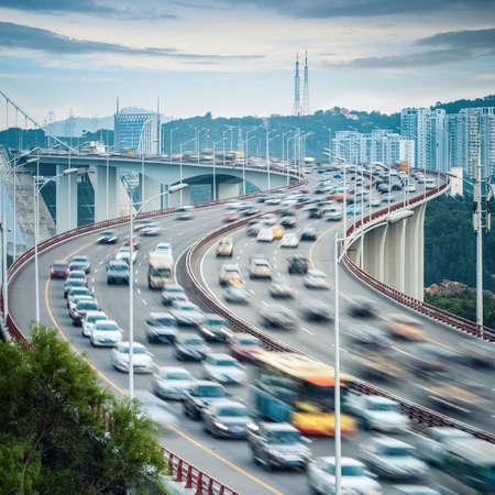 xiamen haicang bridge at dusk , vehicles motion blur with curve shape closeup  photo
