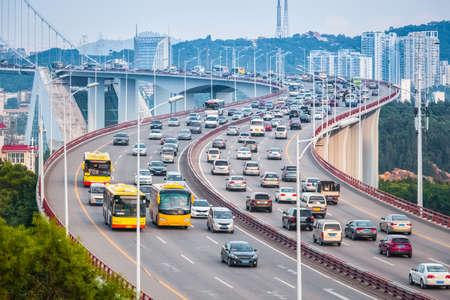 busy traffic closeup on xiamen haicang bridge and graceful curve shape  photo