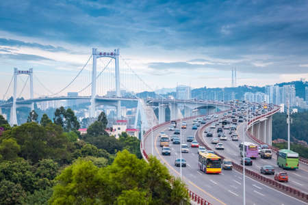 xiamen haicang bridge at dusk with busy traffic and graceful curve shape closeup