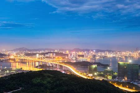 xiamen skyline at night ,aerial view of haicang bridge and beautiful coastal city  photo