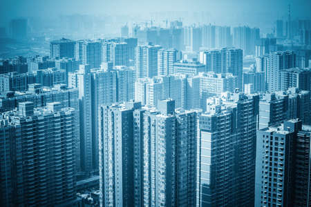 commercial real estate: urban forest new real estate buildings , haze and excessive development
