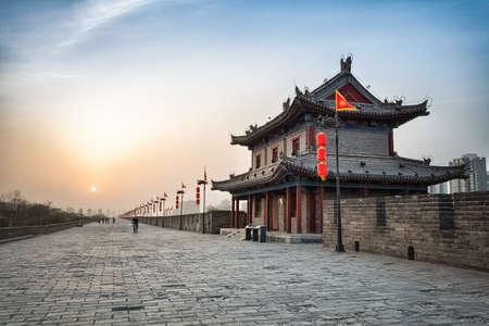 ancient civilization: xian city wall and ancient tower at dusk, hdr image