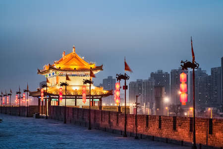 past civilizations: xian ancient tower on the city wall in nightfall   Editorial