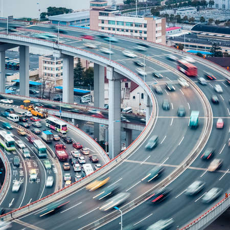 multiple lane highway: vehicles  motion blur on the approach bridge ,  busy traffic closeup Stock Photo