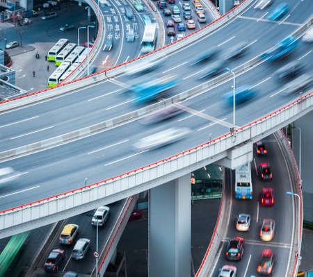 multiple lane highway: automobile motion blur on the approach bridge , abstract busy traffic closeup