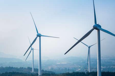 wind farm closeup ,new energy with fog and haze weather Foto de archivo