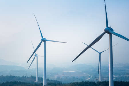 power in nature turbine: wind farm closeup ,new energy with fog and haze weather Stock Photo