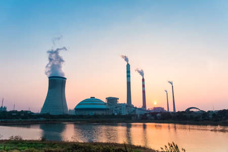 cooling tower: industry landscape of power plant in sunset