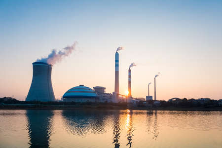 fuel and power generation: coal power station in sunset , industrial landscape Editorial