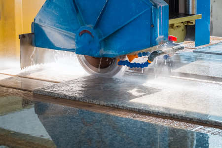 cutting granite closeup , infrared ray electric column  bridge style cutting machine
