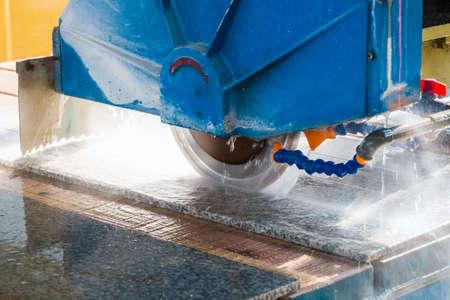stone processing closeup , infrared ray electric column  bridge style cutting machine