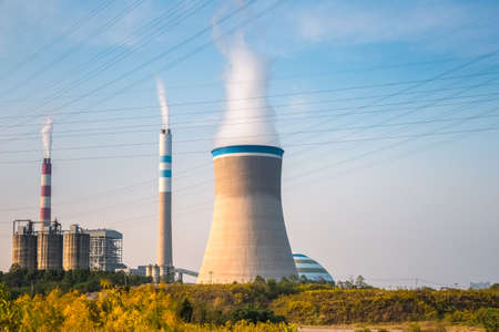 exhalation: coal power plant in the afternoon , industrial landscape Editorial