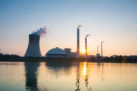 coal fired: thermal power plant with the setting sun , industrial landscape