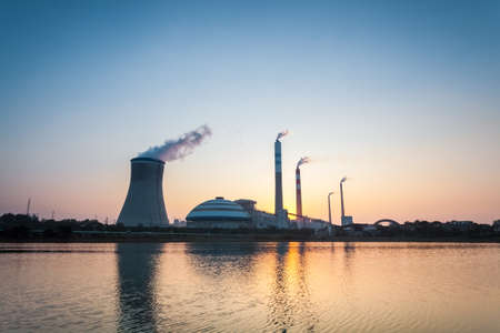 coal fired: coal fired power station in sunset , industrial landscape